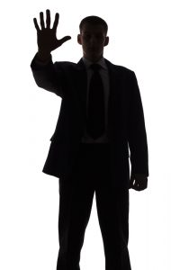 Silhouette of Man Saying Stop - What's Your Relationship With Aging? - ChangingAging.org