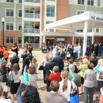 """Baltimore City College Choir singing after ceremonial """"first pitch"""" celebrating the Green House Residences at Stadium Place"""