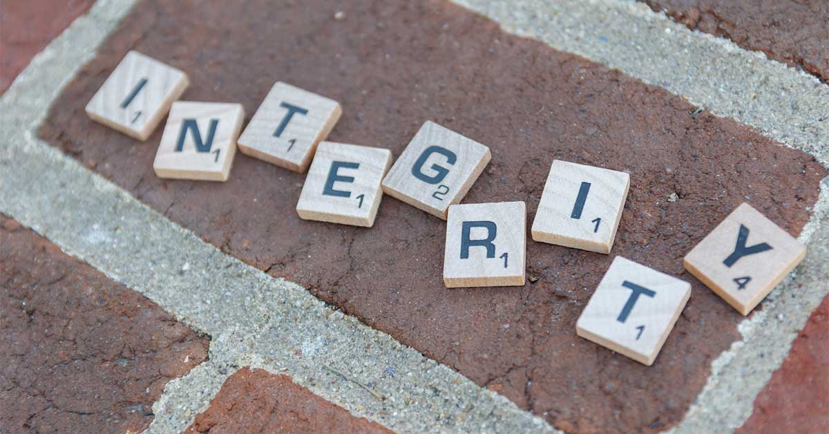 Integrity - Scrabble Pieces on Brick - ChangingAging.org
