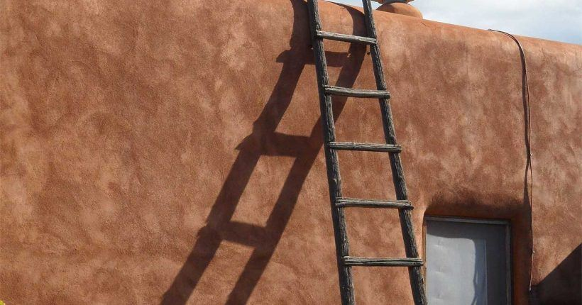 Ladder leaning on an wall of an adobe structure