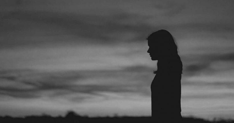 Silhouette of woman thinking (black & white)